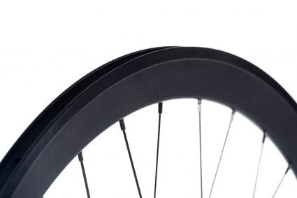 Black rim with anodized brake surface on a white background. 8bar MEGA wheel