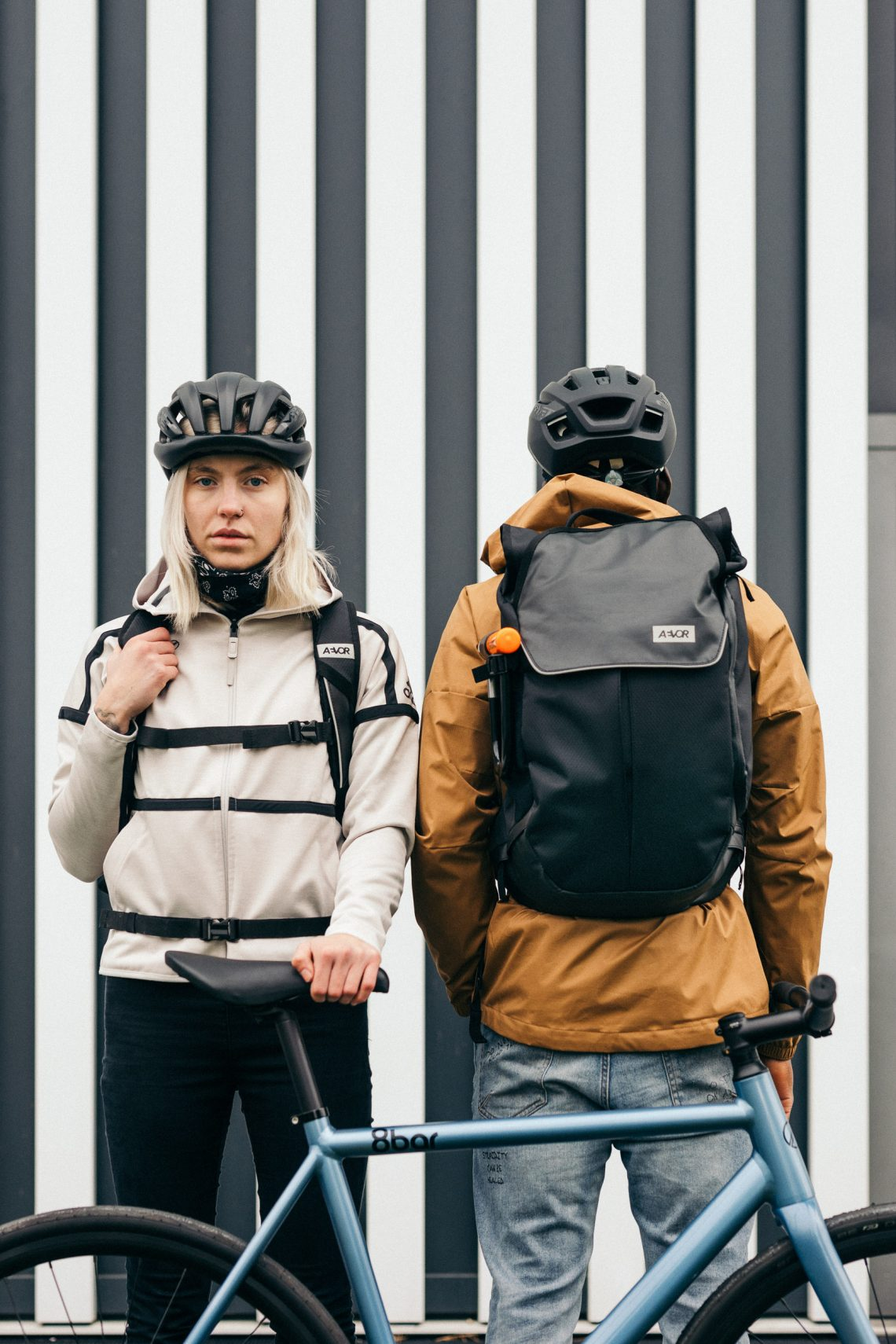 two cyclists with aevor backpack