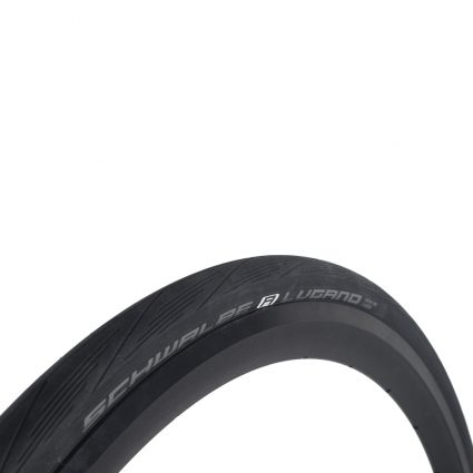 Bike tire mounted on a black rim. White background. Schwalbe Lugano