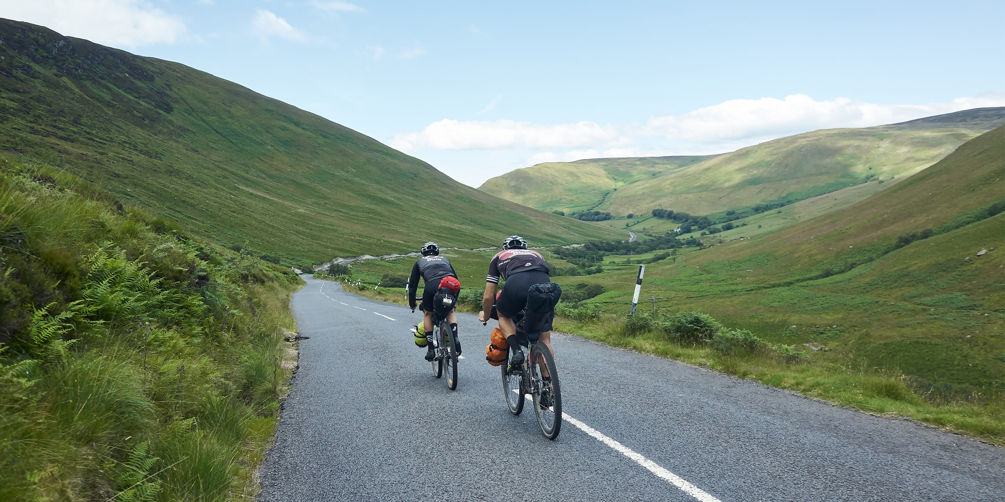 8bar cyclists on the road bikepacking mountains