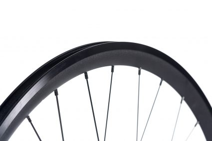 Black rim with anodized brake surface on a white background. 8bar SUPER wheel